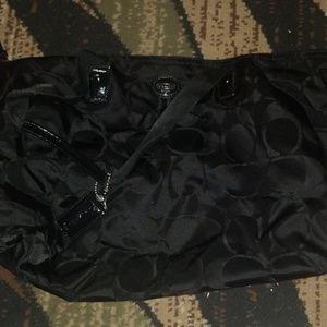 Coach travel bag with makeup bag